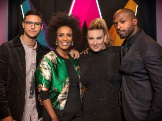 the hosts of Sweden's melodifestivalen 2019 look into the camera and smile